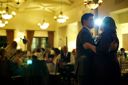 Groom and his mom share a special dance at the wedding reception